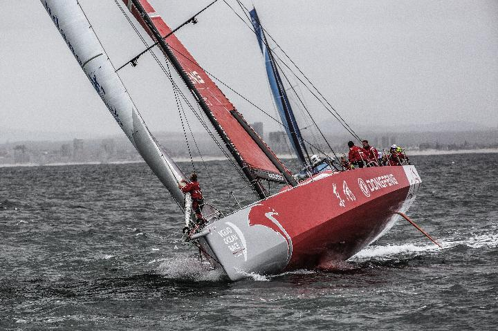 Team Dongfeng from China (left)compete during the in port race of the Volvo Ocean Race in Table Bay in Cape Town, South Africa on November 15, 2014