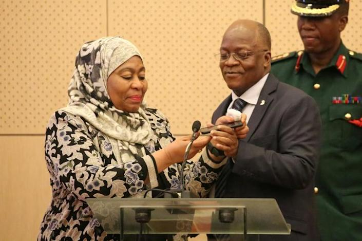 Under Tanzania's constitution, Vice President Samia Hassan Suluhu (L) will become the country's first female president and will consult the ruling CCM party over the appointing of a new vice president