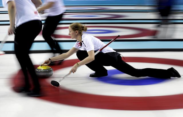 Denmark's Helle Simonsen delivers the rock during the women's curling competition against Russia at the 2014 Winter Olympics, Monday, Feb. 10, 2014, in Sochi, Russia. (AP Photo/Wong Maye-E)