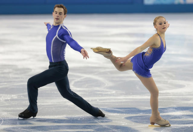 Julia Lavrentieva and Yuri Rudyk of Ukraine compete in the pairs short program figure skating competition at the Iceberg Skating Palace during the 2014 Winter Olympics, Tuesday, Feb. 11, 2014, in Sochi, Russia. (AP Photo/Ivan Sekretarev)