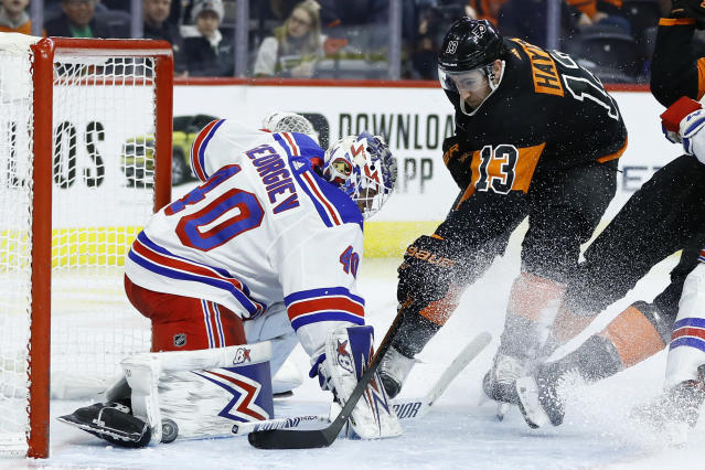 Philadelphia Flyers' Kevin Hayes (13) cannot get a shot past New York Rangers' Alexandar Georgiev (40) during the second period of an NHL hockey game, Friday, Feb. 28, 2020, in Philadelphia. (AP Photo/Matt Slocum)