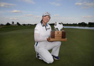 Jin Young Ko, of South Korea, holds the winner's trophy after her victory in the LPGA Volunteers of America Classic golf tournament in The Colony, Texas, Sunday, July 4, 2021. (AP Photo/Ray Carlin)