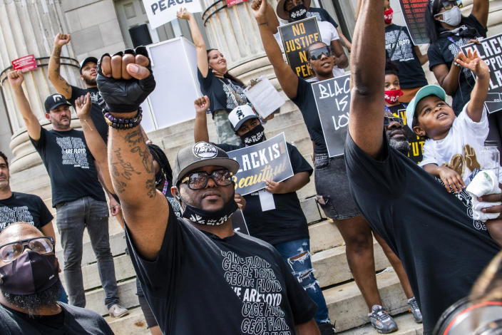 Terrence Floyd, brother of George Floyd, raises his fist with others during a rally on Sunday, May 23, 2021, in Brooklyn borough of New York. George Floyd, whose May 25, 2020 death in Minneapolis was captured on video, plead for air as he was pinned under the knee of former officer Derek Chauvin, who was convicted of murder and manslaughter in April 2021. (AP Photo/Eduardo Munoz Alvarez)