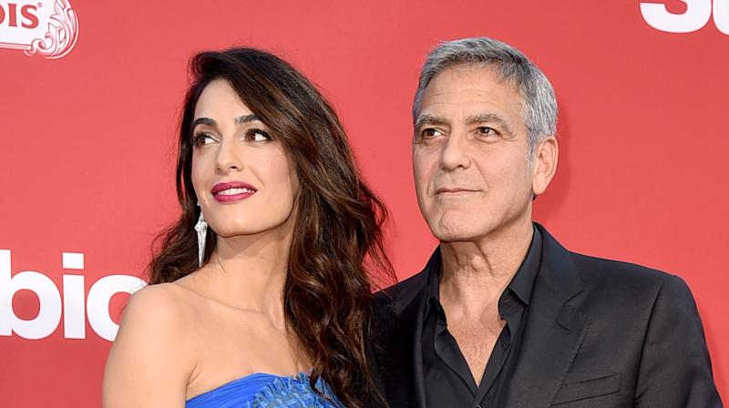 George Clooney and wife Amal Clooney's plan to march in support of the Florida high school shooting's survivors has inspired Oprah to match their related donation of a half-million dollars.