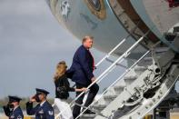 U.S. President Donald Trump boards Air Force One with first lady Melania Trump at Palm Beach International Airport in Florida