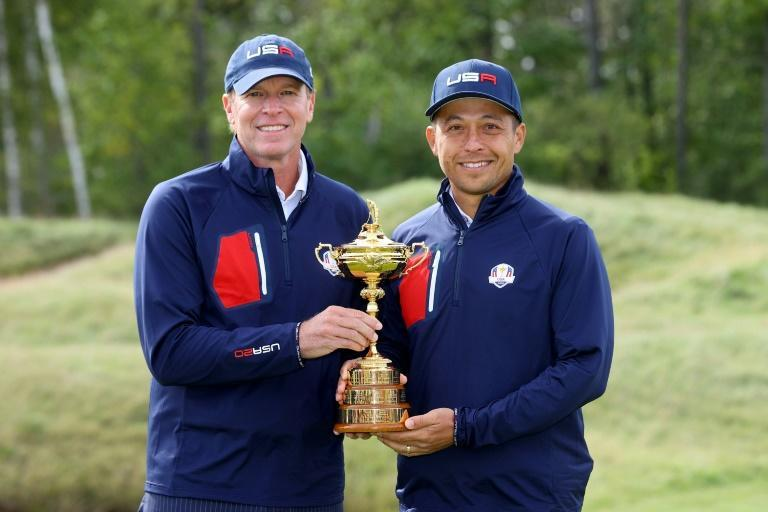 US captain Steve Stricker, left, and Tokyo Olympic champion Xander Schauffele, a US Ryder Cup rookie, hope to be holding the trophy on Sunday night after the conclusion of the team golf showdown against Europe at Whistling Straits (AFP/Andrew Redington)