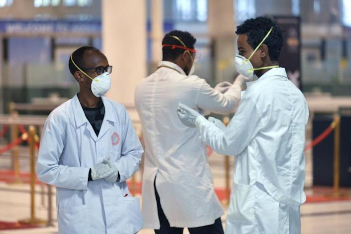 Medical staff of the Ethiopian Ministry of Health prepare to screen passengers at Bole International Airport in Addis Ababa (AFP Photo/Michael Tewelde )