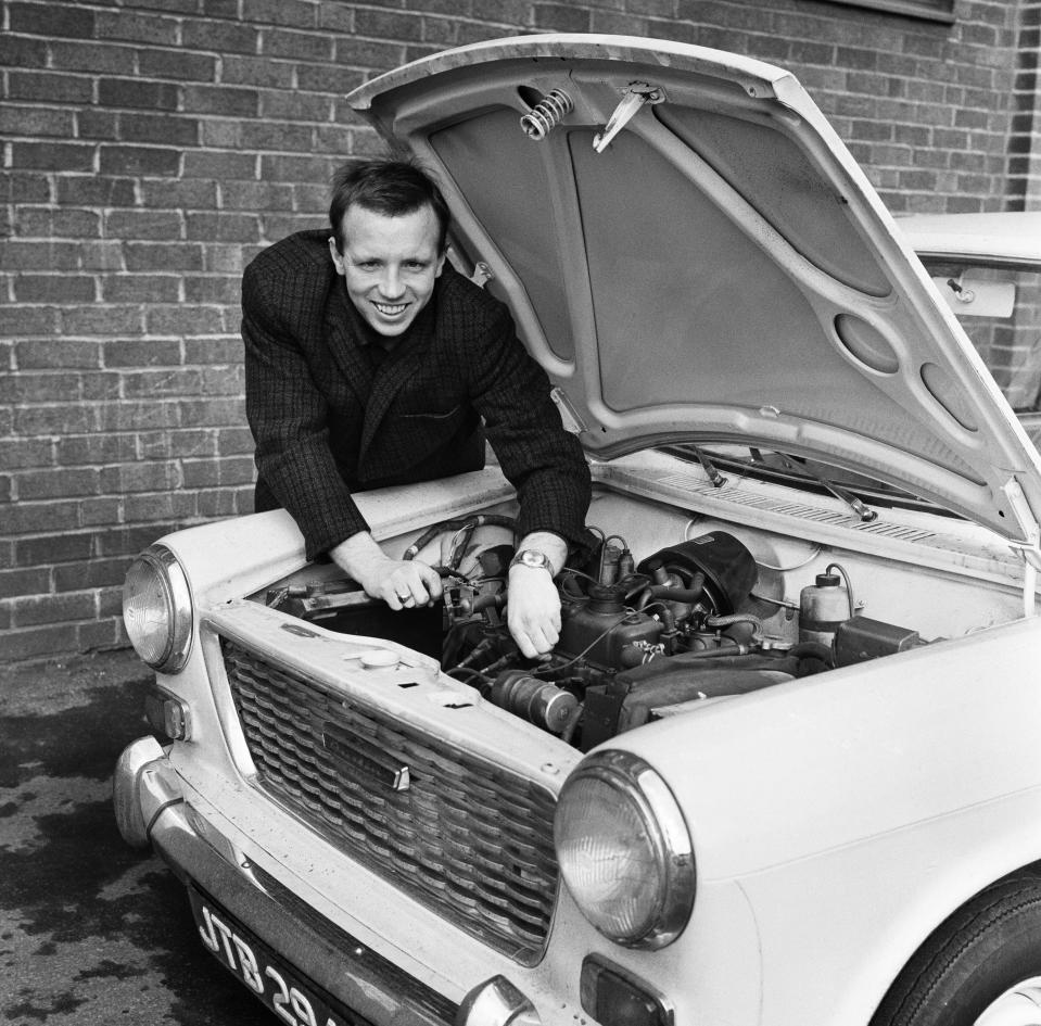 Manchester United and England footballer Nobby Stiles tends to his car engine at Old Trafford after a training session, 9th March 1965. (Photo by Eastwood/Mirrorpix/Getty Images)