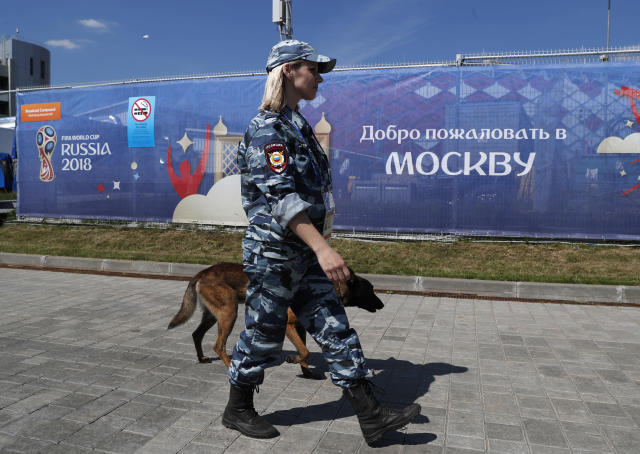 FILE - In the June 16, 2018 file photo a police officer patrols outside the stadium ahead of the group D match between Argentina and Iceland at the 2018 soccer World Cup in the Spartak Stadium in Moscow, Russia. (AP Photo/Rebecca Blackwell, file)