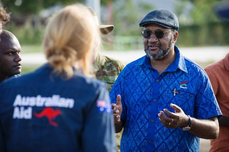 A handout photo from the Australian Defence Force shows Prime Minister of Vanuatu Charlot Salwai (R) passing his thanks to the Deputy High Commissioner for Operation Vanuatu Assist 2017 (AFP Photo/Jake Badior)