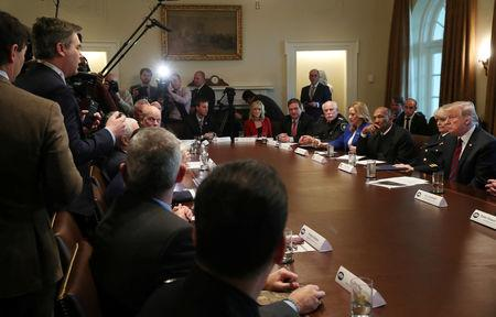 "U.S. President Donald Trump listens to a question from CNN White House correspondent Jim Acosta (L) as the president hosts a ""roundtable discussion on border security and safe communities"" with state, local, and community leaders in the Cabinet Room of the White House in Washington, U.S., January 11, 2019. REUTERS/Leah Millis"