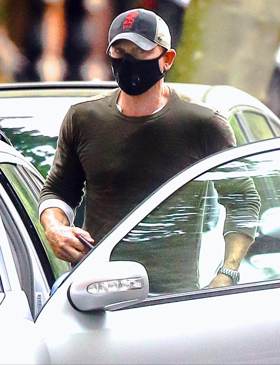 <p>Daniel Craig is seen getting into his car while running errands in a baseball cap and face mask in N.Y.C. on Monday.</p>