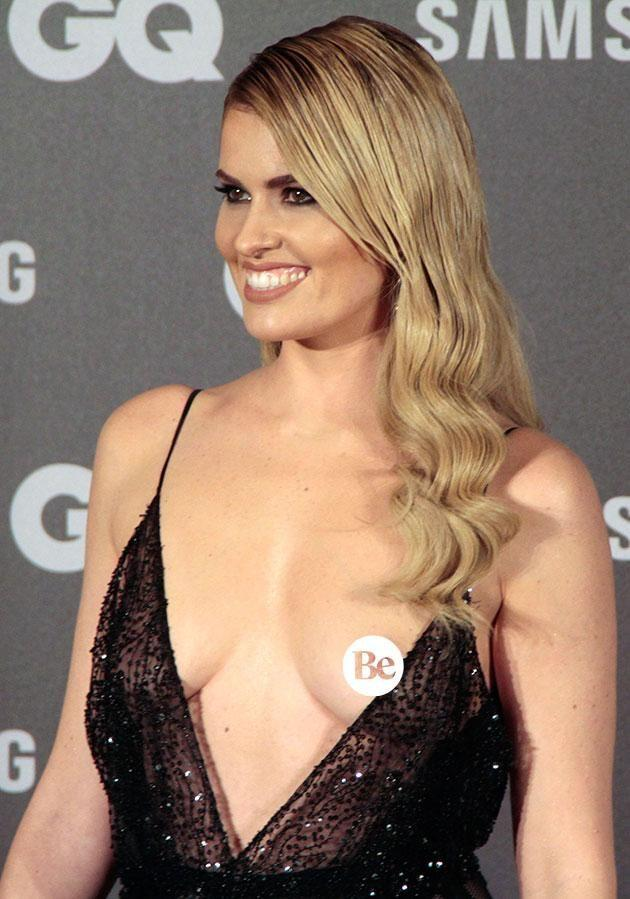 Adriana did not seem to notice her breast was exposed while she posed for photographers on the red carpet. Photo: Getty