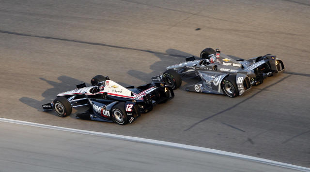 Will Power, left, of Australia, and Tony Kanaan, of Brazil, drive through a turn during the IndyCar auto race at Texas Motor Speedway in Fort Worth, Texas, Saturday, June 7, 2014. (AP Photo/Ralph Lauer)