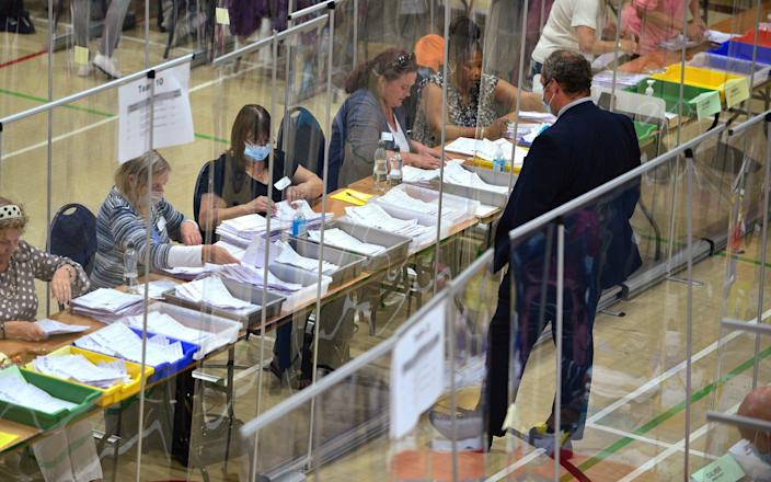 Election officials count the ballots in the Chesham and Amersham By-Election at Chesham Leisure Centre on June 17, 2021 - Jim Dyson/Getty Images