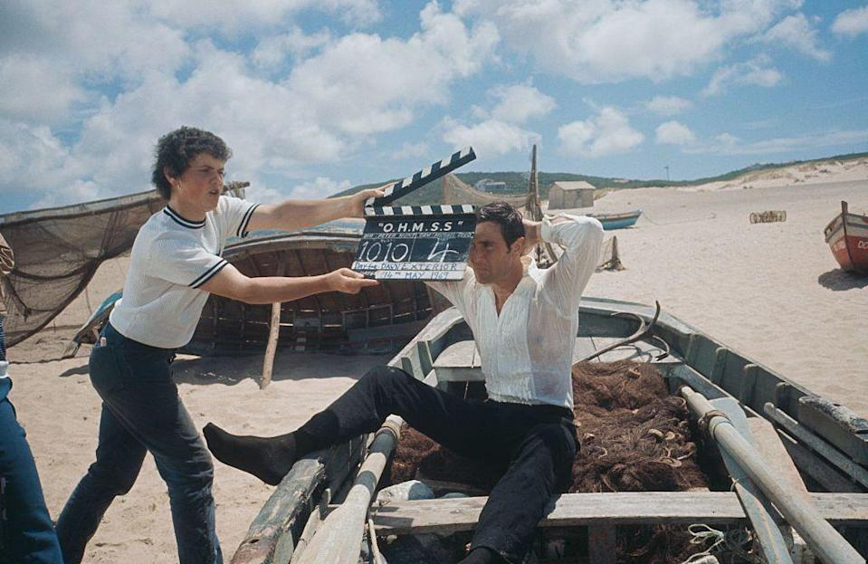 <p>George Lazenby films a scene for 'On Her Majesty's Secret Service' on location on the Praia do Guincho (Guincho Beach), near Cascais in Portugal, 1969. </p>