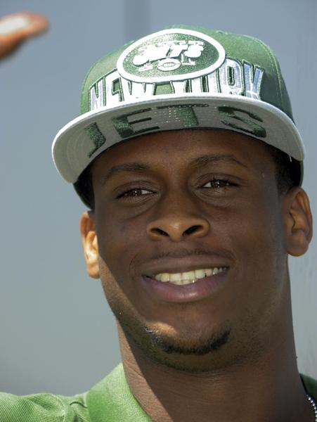 Quarterback Geno Smith, from West Virginia, speaks to reporters following a news conference after being selected Friday by the New York Jets with the seventh pick in the second round, 39th overall, in the NFL football draft, Saturday April 27, 2013 in Florham Park, N.J. (AP Photo/Joe Epstein)