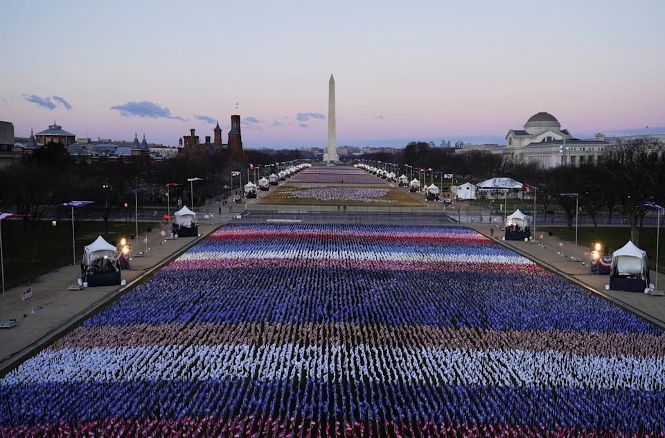 <p>The 'Field of Flags' and the Washington Monument are seen on the National Mall in front of the Capitol building</p> (AFP via Getty)