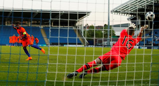 Soccer Football - UEFA European Under-17 Championship Quarter-Final - Netherlands vs Republic of Ireland - Proact Stadium, Chesterfield, Britain - May 14, 2018 Netherland's Daishawn Redan has a penalty saved by Ireland's James Corcoran before he is adjudged to have left his line and is sent off Action Images via Reuters/Jason Cairnduff