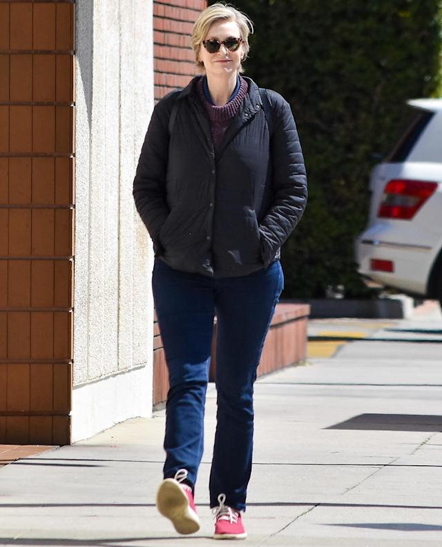 <p>Jane Lynch soaks up the sunshine solo on Thursday in Los Angeles. </p>