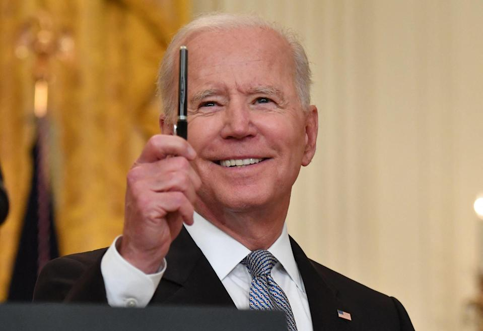 <p>US President Joe Biden delivers remarks on the COVID-19 response and the vaccination in the East Room at the White House in Washington, DC on May 17, 2021.</p> (Photo by NICHOLAS KAMM/AFP via Getty Images))