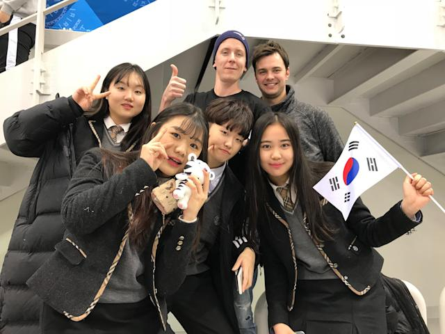 A group of young Korean fans pose with two generous Canadian translators.