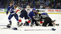 Tampa Bay Lightning left wing Ross Colton (79) and Florida Panthers defenseman Markus Nutivaara (65) fight during the third period in Game 4 of an NHL hockey Stanley Cup first-round playoff series Saturday, May 22, 2021, in Tampa, Fla. (AP Photo/Chris O'Meara)