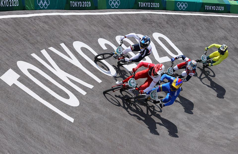 <p>TOKYO, JAPAN - JULY 29: (L-R) Alfredo Campo of Team Ecuador, David Graf of Team Switzerland, Carlos Alberto Ramirez Yepes of Team Colombia, Connor Fields of Team United States and Anthony Dean of Team Australia as they compete during the Men's BMX quarterfinal heat 4, run 2 on day six of the Tokyo 2020 Olympic Games at Ariake Urban Sports Park on July 29, 2021 in Tokyo, Japan. (Photo by Laurence Griffiths/2021 Getty Images)</p>