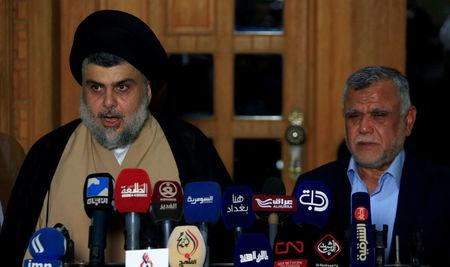 Iraqi Shi'ite cleric Moqtada al-Sadr speaks during a news conference with Leader of the Conquest Coalition and the Iran-backed Shi'ite militia Badr Organisation Hadi al-Amiri, in Najaf, Iraq June 12, 2018. REUTERS/Alaa al-Marjani