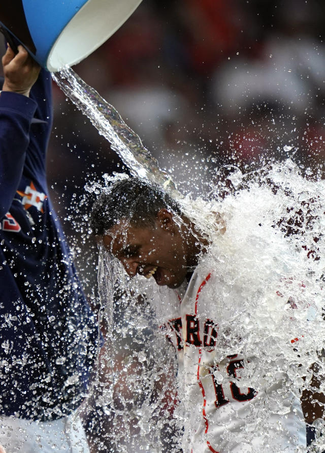 Houston Astros' Tony Kemp (18) is doused with water by Lance McCullers Jr. after hitting the game-winning home run against the Cleveland Indians during the 10th inning of a baseball game Saturday, April 27, 2019, in Houston. The Astros won 4-3. (AP Photo/David J. Phillip)