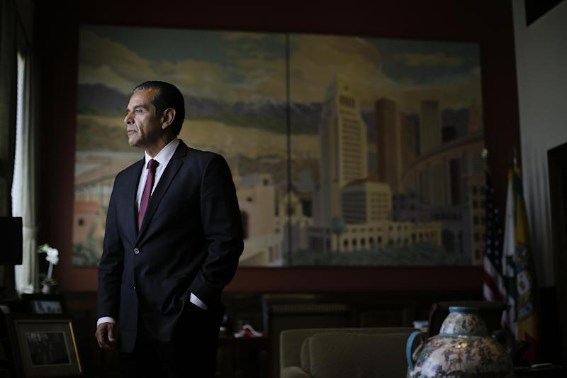 Los Angeles Mayor Antonio Villaraigosa pauses for photos in his office in Los Angeles, Wednesday, June 19, 2013. Mayor Antonio Villaraigosa leaves office July 1 after an eight-year run at City Hall that began full of promise and ends with mixed results. (AP Photo/Jae C. Hong)