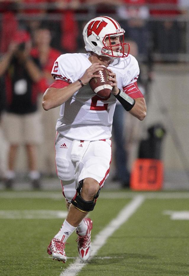 Wisconsin quarterback Joel Stave drops back to pass against Ohio State during the first quarter of an NCAA college football game Saturday, Sept. 28, 2013, in Columbus, Ohio. (AP Photo/Jay LaPrete)