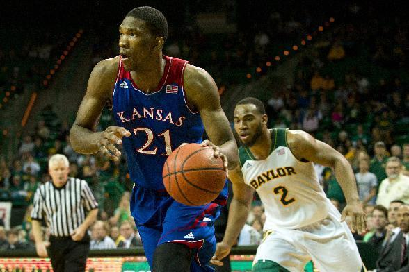 Joel Embiid of the Kansas Jayhawks drives to the basket against the Baylor Bears on February 4, 2014 at the Ferrell Center in Waco, Texas (AFP Photo/Cooper Neill)