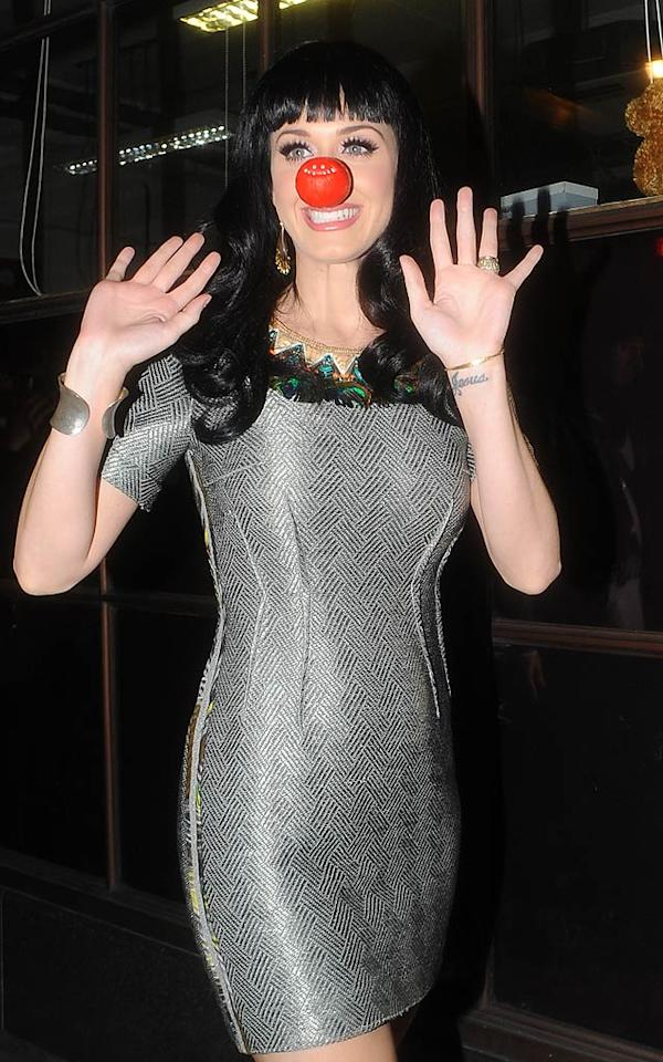 "After wowing the crowd at her sellout concert in London Thursday night, Katy Perry made a surprise appearance at DJ Chris Moyles' Radio 1 show around 1:30 a.m. the very same night! Katy donned a metallic Matthew Williamson sheath and a red clown nose to support Moyles, who is currently doing a marathon 51-hour live show to raise awareness for <a href=""http://www.rednoseday.com"" target=""new"">Red Nose Day</a>, a country-wide event held by the UK's Comic Relief charity to benefit people in need across the UK and Africa. <a href=""http://www.splashnewsonline.com"" target=""new"">Splash News</a> - March 17, 2011"