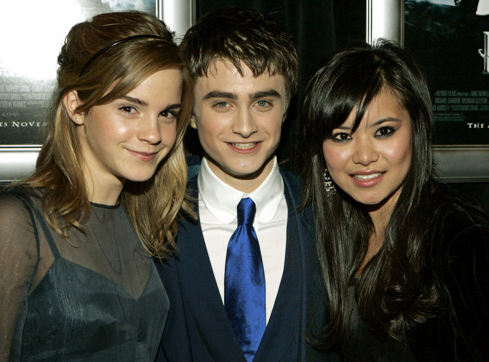Harry Potter co-stars, from left, Emma Watson, Daniel Radcliffe, and Katie Leung, pose for photographers at the United States premiere of the film