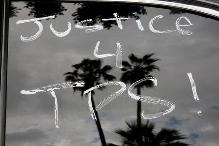 Paint is seen on cars before members of the Teamsters Union participate in a tractor trailer caravan surrounding the LA Metro Detention Center in support of port truck drivers and others threatened by deportation if the courts or congress don't stop the termination of Temporary Protected Status (TPS) in Los Angeles, California, U.S. October 3, 2018.     REUTERS/Kyle Grillot