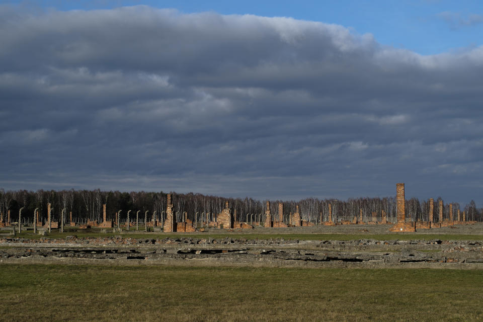 The remains of brick stone chimneys of prisoners barracks inside the former Nazi death camp of Auschwitz Birkenau or Auschwitz II. in Oswiecim, Poland, Sunday, Dec. 8, 2019. The commemorations for the victims of the Holocaust at the International Holocaust Remembrance Day, marking the liberation of Auschwitz-Birkenau on Jan. 27, 1945, will be mostly online in 2021 due to the coronavirus pandemic. (AP Photo/Markus Schreiber)