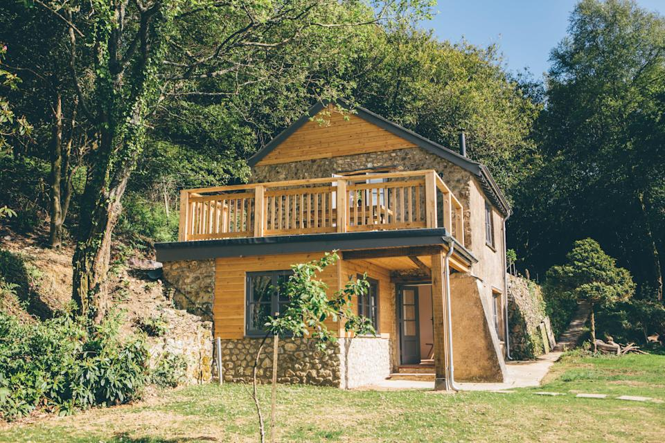 """<strong><a href=""""http://airbnb.pvxt.net/4ee7yM"""" rel=""""nofollow noopener"""" target=""""_blank"""" data-ylk=""""slk:Hillside Hideaway, Dorset"""" class=""""link rapid-noclick-resp"""">Hillside Hideaway, Dorset </a></strong><br><br>This one-bedroom cottage has panoramic views over Lyme Bay and a freestanding bath. There's even a lovely old oak tree you can read under – idyllic, tbh.<br><br><em>From £169 per night</em>"""