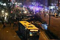Police, firefighters and emergency services work at the site of a blast in Ankara on March 13, 2016