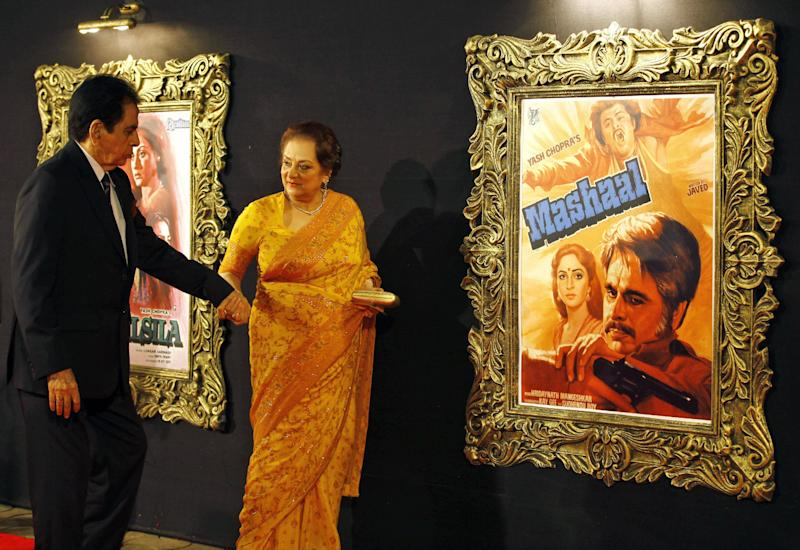"In this Monday, Nov. 12, 2012 photo, Bollywood star Dilip Kumar arrives with his wife Saira Banu to attend the premiere of the film ""Jab Tak Hai Jaan"" or ""As Long As I Am Alive"" in Mumbai, India. Bollywood stars turned out in strength at the premiere of the movie for a final homage to movie mogul Yash Chopra, who died last month days after finishing the film. Chopra was known as the ""King of Romance"" for creating classic love stories that were immensely popular. (AP Photo/Rafiq Maqbool)"