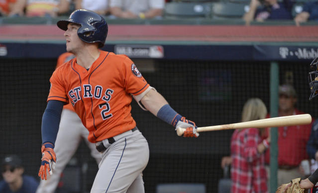 Houston Astros' Alex Bregman watches his RBI-single in the ninth inning during Game 3 of a baseball American League Division Series against the Cleveland Indians, Monday, Oct. 8, 2018, in Cleveland. Tony Kemp scored on the play. (AP Photo/Phil Long)