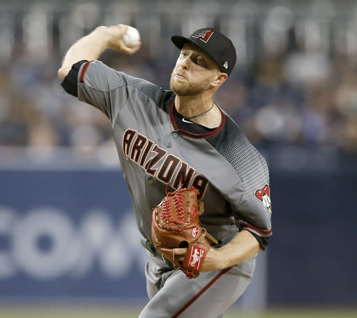 Arizona Diamondbacks starting pitcher Merrill Kelly delivers to a San Diego Padres batter during the first inning of a baseball game in San Diego, Monday, April 1, 2019. (AP Photo/Alex Gallardo)