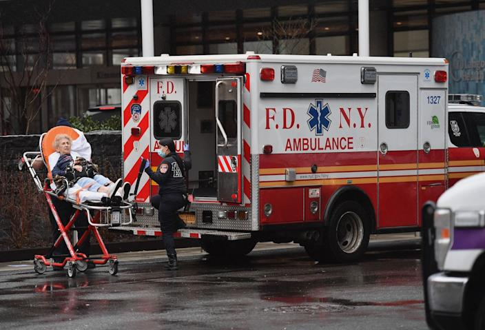 An elderly person arrives on a stretcher, and is admitted to NYU Langone Health Center hospital on March 23, 2020 in New York City.