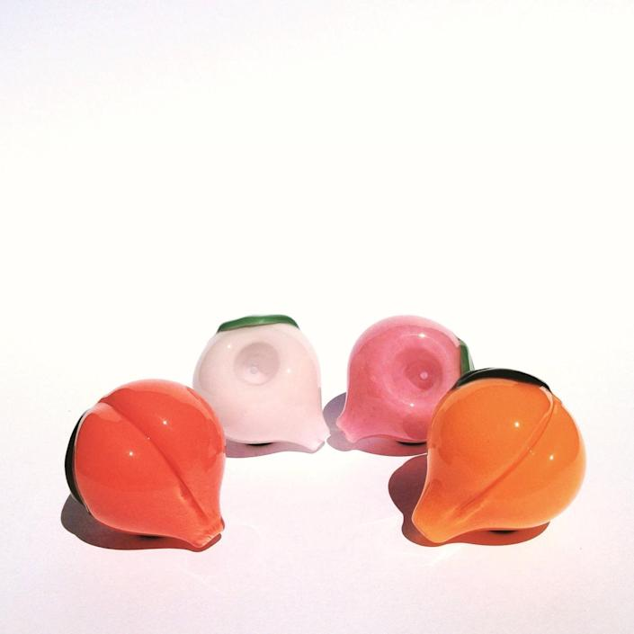"""<h2>HumblePrideGlass Peach-shaped Glass Pipes</h2><br>You could say we're peachy keen on these fruity glass pipes. Who wouldn't be?<br><br><em>Shop</em> <strong><em><a href=""""https://www.etsy.com/shop/HumblePrideGlass"""" rel=""""nofollow noopener"""" target=""""_blank"""" data-ylk=""""slk:HumblePrideGlass"""" class=""""link rapid-noclick-resp"""">HumblePrideGlass</a></em></strong><br><br><strong>HumblePrideGlass</strong> Peach-shaped Glass Pipes, $, available at <a href=""""https://go.skimresources.com/?id=30283X879131&url=https%3A%2F%2Fwww.etsy.com%2Flisting%2F479798930%2Fcute-peach-shaped-glass-pipes-in-4"""" rel=""""nofollow noopener"""" target=""""_blank"""" data-ylk=""""slk:Etsy"""" class=""""link rapid-noclick-resp"""">Etsy</a>"""