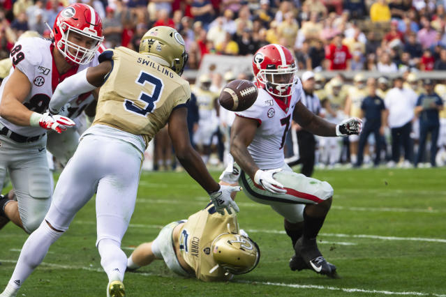 Georgia running back D'Andre Swift (7) fumbles as Georgia Tech linebacker David Curry and defensive back Tre Swilling (3) defend with tight end Charlie Woerner (89) moving in to block during the second half of an NCAA college football game Saturday, Nov. 30, 2019 in Atlanta. Swilling recovered and Swift was hurt on the play. Georgia won 52-7. (AP Photo/John Amis)
