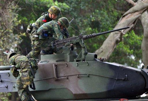 Taiwan soldiers climb on a tank during last year's drill simulating a Chinese military invasion in Tamshui