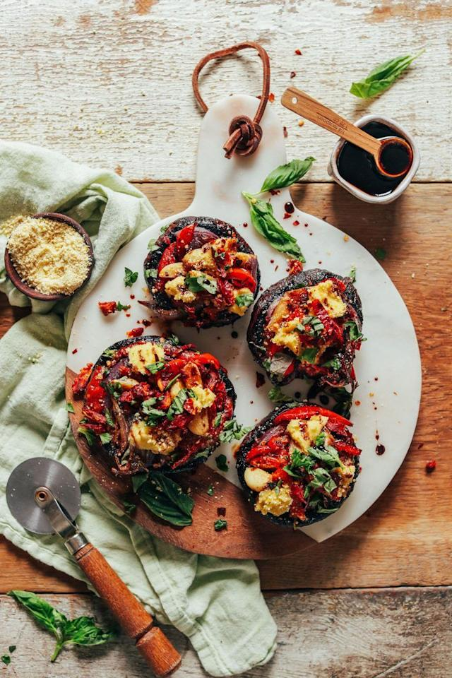 """<p>Topped with macadamia nut cheese, sun-dried tomatoes, and thinly sliced veggies, these zesty pizza bites are as tasty as they are adorable.<br></p><p><a class=""""body-btn-link"""" href=""""https://minimalistbaker.com/balsamic-marinated-portobello-pizzas/"""" target=""""_blank"""">GET THE RECIPE</a></p><p><em>Per serving: 301 calories, 22 g fat (3 g saturated), 23 g carbs, 12 g sugar, 179 mg sodium, 5 g fiber, 6 g protein</em></p>"""