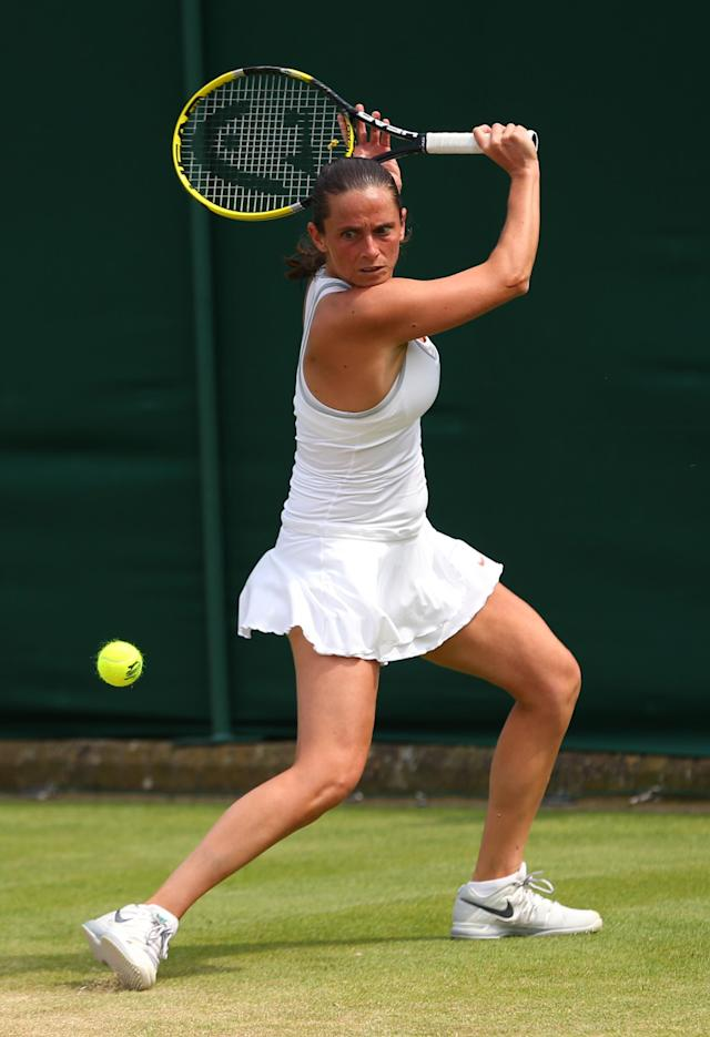 LONDON, ENGLAND - JUNE 27: Roberta Vinci of Italy plays a backhand during the Ladies' Singles second round match against Jana Cepelova of Slovakia on day four of the Wimbledon Lawn Tennis Championships at the All England Lawn Tennis and Croquet Club on June 27, 2013 in London, England. (Photo by Julian Finney/Getty Images)