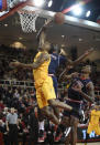 St. John's guard Sir'Dominic Pointer (15) blocks Long Beach State's guard Branford Jones's (14) shot at the basket as St. John's forward Chris Obekpa (12) looks on during the first half of an NCAA college basketball game Monday, Dec. 22, 2014 in New York. (AP Photo/Kathy Kmonicek)