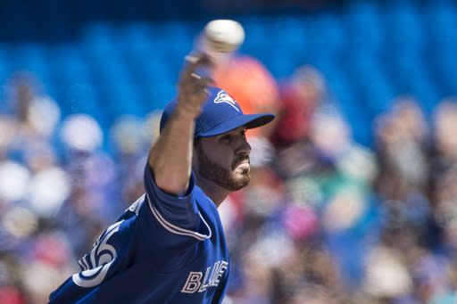 Toronto Blue Jays starting pitcher Drew Hutchinson works against the Tampa Bay Rays during first-inning baseball game action in Toronto, Sunday, Aug. 24, 2014. (AP Photo/The Canadian Press, Chris Young)